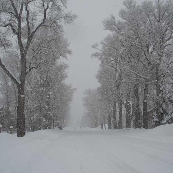 Traffic on Main Street is minimal while during a storm the snow is plentiful.